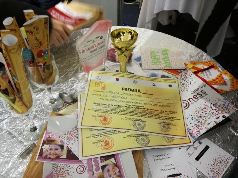 Premii pentru elevii Colegiului Economic din Alba Iulia la Târgul Firmelor de Exercițiu de la Baia Mare